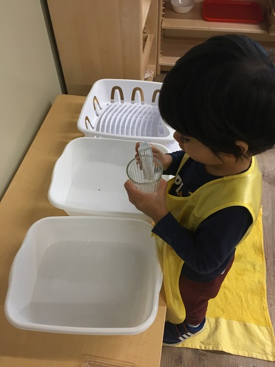Practicing practical life skills at Spark Montessori School